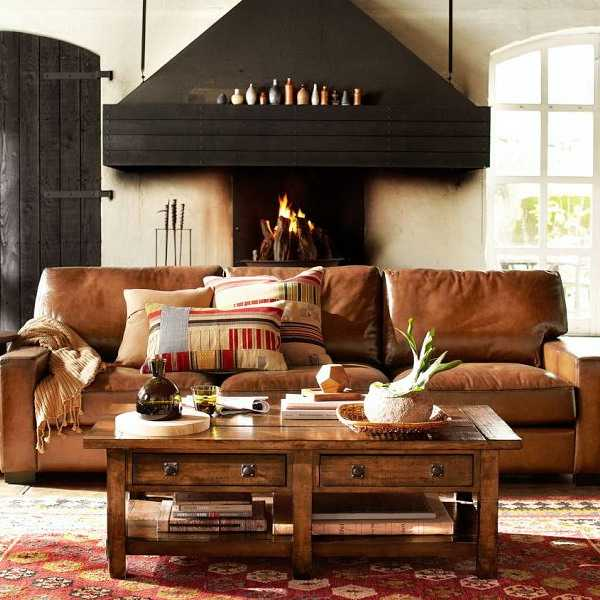 cozy interior with leather sofa and open space fireplace