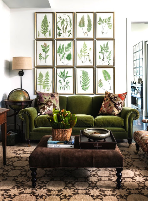 harpers bazaar botanical print gallery wall living room velvet sofa ottoman cococozy