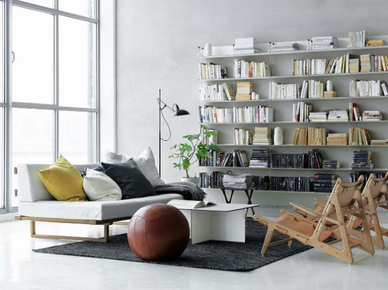 White-Scandinavian-Living-Room-Bookshelves-at-Modern-House-with-Modern-Interior-Style-by-Petra-Bindel